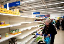 The UK government will give supermarkets access to its databases in a bid to prioritise deliveries to elderly and vulnerable customers.This comes after reports from food charities that millions of people in the UK will need food aid in the coming days, unless the government intervenes.