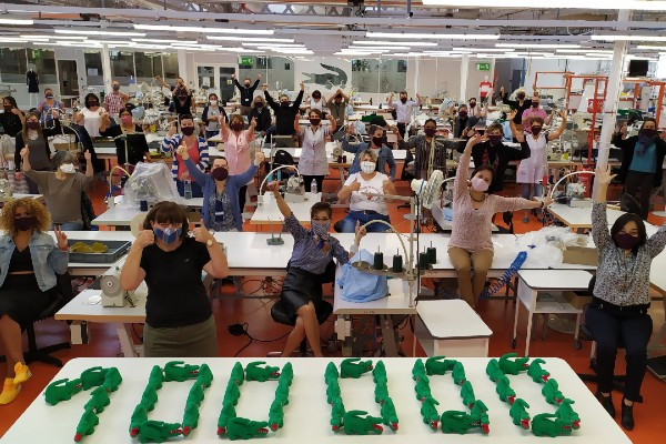 Lacoste has reached the milestone of producing 100,000 face masks in just a few weeks to help fight against the spread of coronavirus and pledges to reach 200,000 masks.