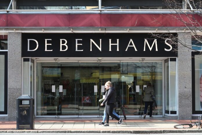 Debenhams to cut hundreds of head office jobs amid reopening plans