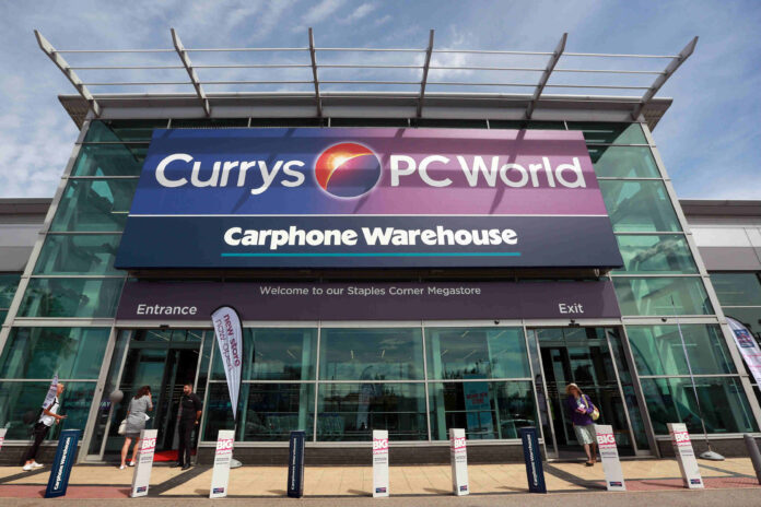 Dixons Carphone full year profits more than halve