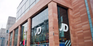 "JD Sports half-year profits slide amid ""weak"" store footfall"