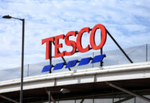 """Tesco chairman John Allan says he will """"defend to the death"""" board decision over dividend"""