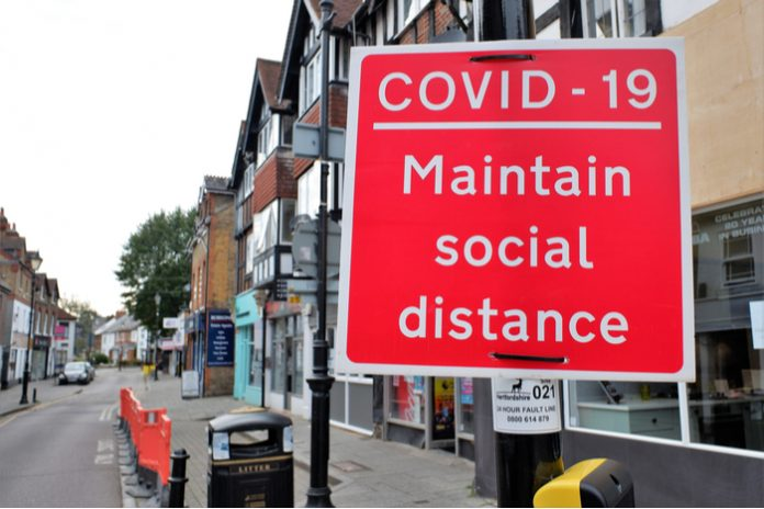 Covid-19 pandemic lockdown store closures administration Boris Johnson online shopping vaccinations National Day of Reflection