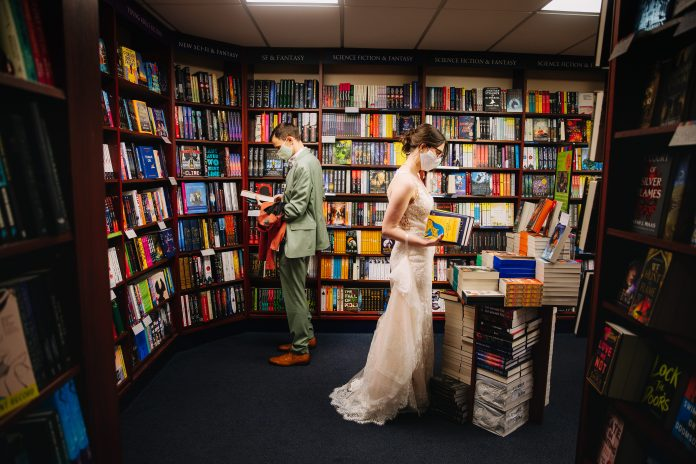 Newlyweds mark wedding day at indie bookshop where they had first date