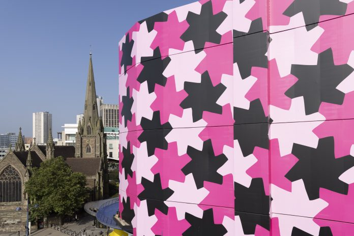 Selfridges transforms the outside of its iconic Birmingham store to showcase a new black and pink patterned design titled Infinity Pattern 1.