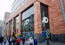 JD Sports reports record first-half results, boosted by pent-up demand for sneakers and sportswear after UK stores reopened from lockdown.ation director amid row over chairman's pay