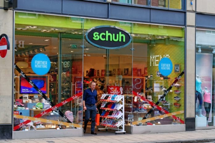 Schuh swings to loss after