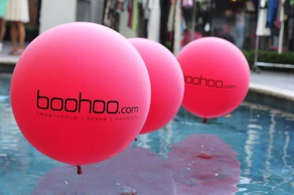 Members from XR Manchester staged a protest outside of Boohoo's head office in Manchester on Monday to