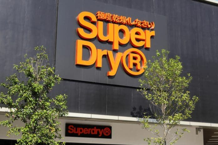 Superdry discounting promotional pricing trading update julian dunkerton CEO